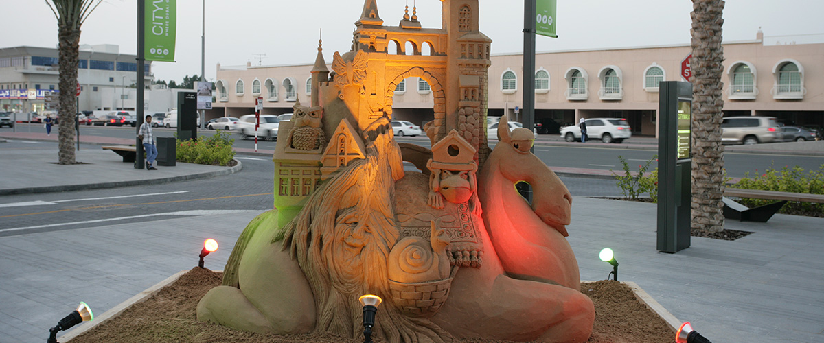 Camel with sandcastle/old man time City Walk Dubai Sculpting Sand – Jennifer Rossen